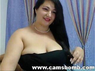 Busty brunette rides on penis on webcam