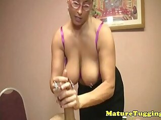 Busty Mature in Nylons Shows Her Body And Sucks Cock