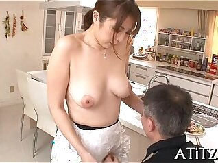 Busty Japanese bouncing off penis and giving oral job